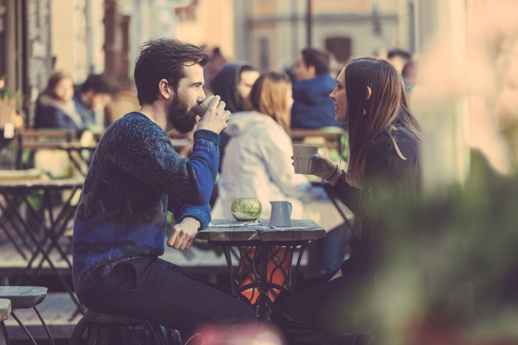 Couple sitting outside and enjoying a coffee together