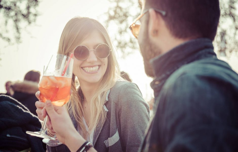 couple enjoying cocktails on sunny day